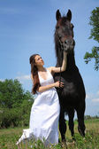 Woman with horse — Стоковое фото