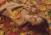 Leaves and girl — Stock Photo