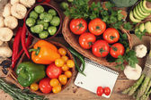 Notebook and vegetables — Stock Photo