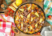 Paella and vegetables — Stock Photo