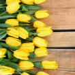 Stock Photo: Tulips on wood