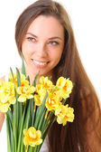 Girl with yellow flowers — Stock Photo