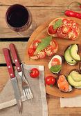Snacks on wooden table — Stockfoto