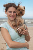 Woman with yorkie — Stock Photo