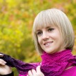 Thoughtful girl holds a scarf — Stock Photo #10918522