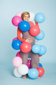 Pregnant woman with balloons — Stock Photo
