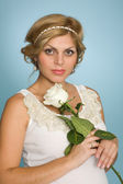 Pregnant woman with a rose — Stock Photo