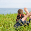 Boy looking at the sea — Stock Photo