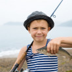 Boy holding a fish — Stock Photo