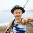 Boy holding a fish — Stock Photo