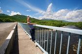 Boy hiker standing on the bridge. — Stock Photo