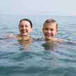 Grandson and grandmother swim in the sea — Stock Photo