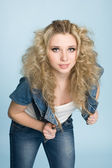 Young girl with blond curly hair — Stock Photo