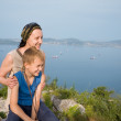 Joyful grandmother and grandson on a mountaintop. — Stock Photo