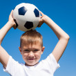 Boy throws a ball — Stock Photo