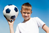 Boy holding a ball. — Stock Photo
