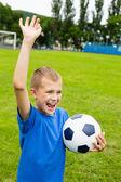 Futbol oynayan çocuk çığlık. — Stok fotoğraf
