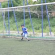 Goalkeeper boy playing football. Joke. — Stock Video