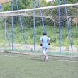 Goalkeeper boy playing football. Joke. — Stok video