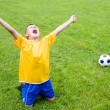 Excited boy football player — Stock Photo