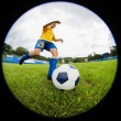 Boy soccer player hits the ball — Stock Photo