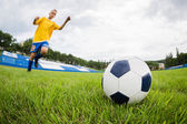 Boy playing football at the stadium. — Stock Photo