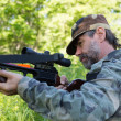 Hunter shoots a crossbow — Foto de Stock