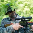 Stock Photo: Hunter aims crossbow.
