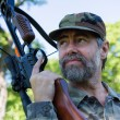 Hunter holding crossbow — Stock Photo #31862505