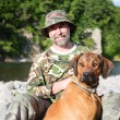 Traveler with RhodesiRidgeback — Stock Photo #31862581