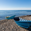 Wooden fishing boats on the sea pebble beach — Foto Stock