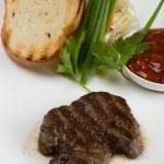 Tenderloin steak on a white plate. — Stock Photo
