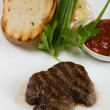 Stock Photo: Tenderloin steak on white plate.