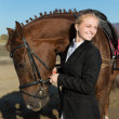 Happy girl teenager with his horse — Stock Photo #33688191