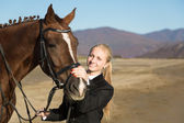 Happy girl teenager with his horse — Stockfoto