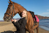 Teenage girl with a favorite horse — Stok fotoğraf