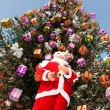 Santa Claus and Christmas tree after snowfall.  — Foto Stock