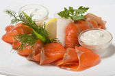 Cold appetizer of smoked halibut, salted trout, sockeye salmon s — Stock Photo