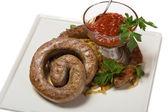 Grilled spicy sausage with sauerkraut — Stock Photo