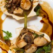 Scallops with asparagus and mushrooms — Stock Photo