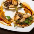Hot starter of scallops with asparagus and mushrooms — Stock Photo