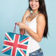 Young happy smiling Asian woman with shopping bag — Foto Stock