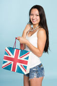 Young happy smiling Asian woman with shopping bag — Stock Photo