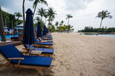 Deck chairs on the beach of Sentosa Island in Singapore. — Stock Photo