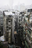 Old apartment blocks Macau China on a rainy day. — ストック写真