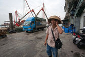 Businessman says on mobile phone in the fishing port in Macau — Stock Photo