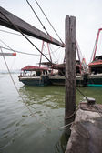 Fishing boats are at the pier at the fishing port in Macau. — Stock Photo
