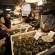Stock Photo: Sellers of fish and buyers at Fish Market in Macau
