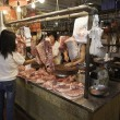 Stock Photo: Sellers meat and buyer in Municipal Market in Macau