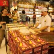 Confectioner manufactures biscuits in candy store in Macau — Stock Photo